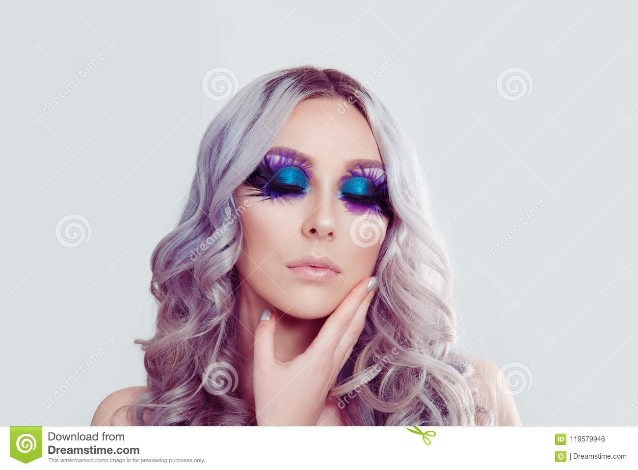 Woman With Artistic Purple Blue Eyes Makeup Feather On