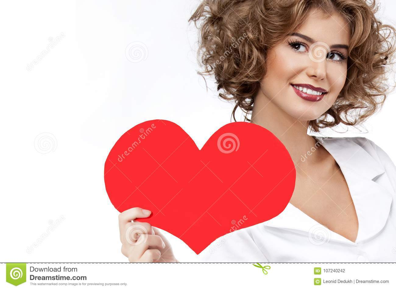 Beauty portrait of caucasian smiling happy woman red heart vale