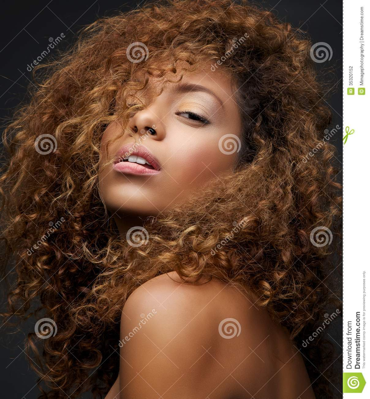 Beauty Portrait Of A Female Fashion Model With Curly Hair