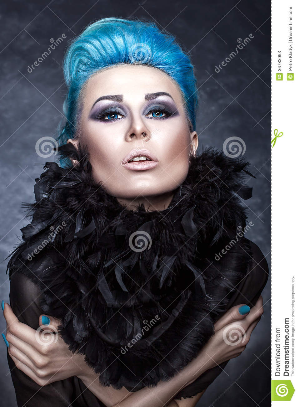 Beauty portrait of a girl with blue hair.