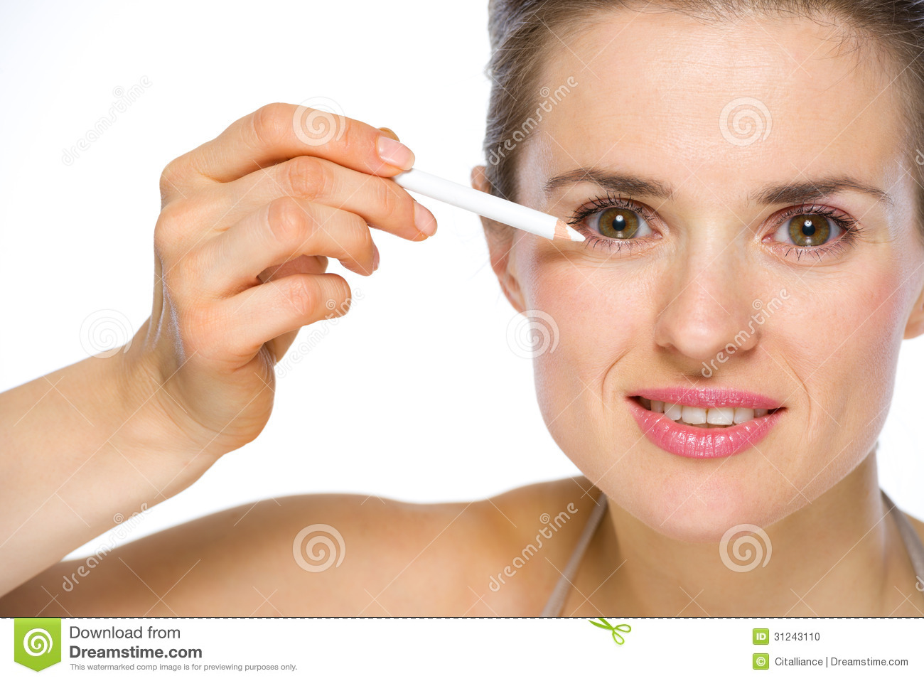 Beauty portrait of woman applying white eye liner