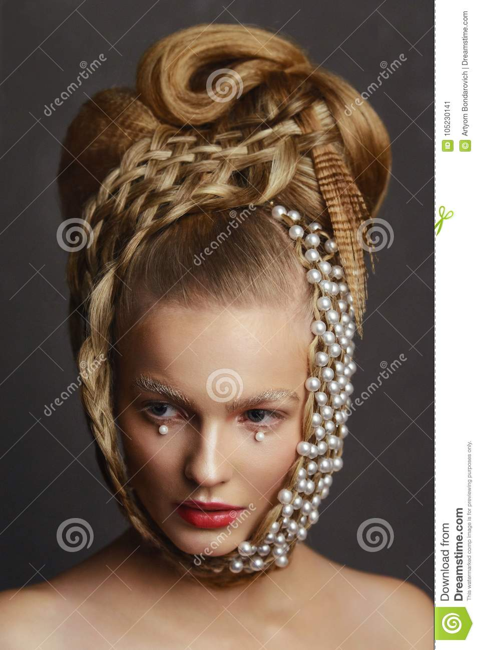 Beauty portrait of young woman with creative fashion hairstyle.