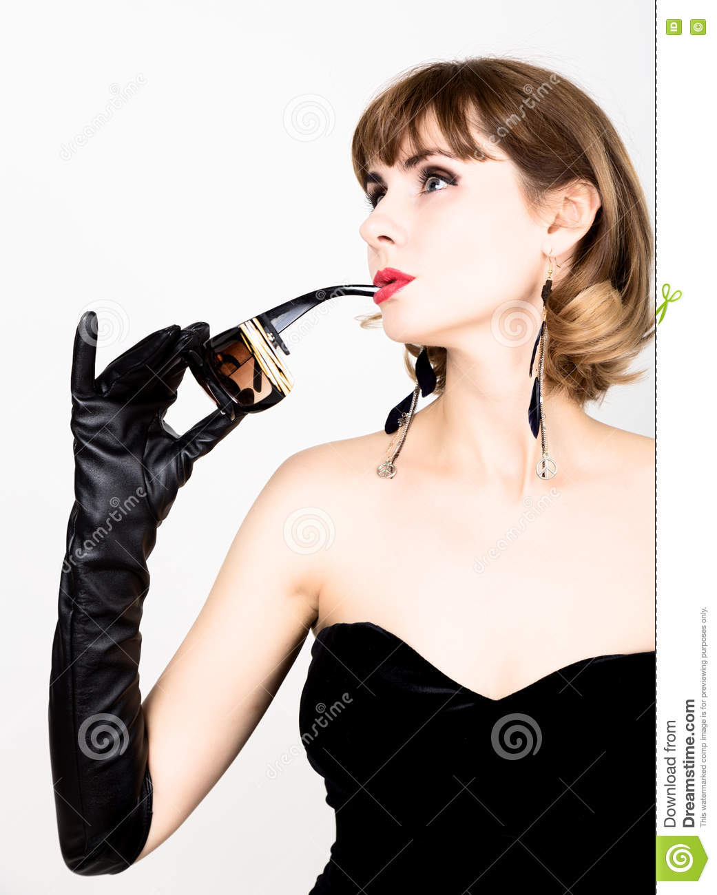 Ladies long vintage leather gloves - Beauty Retro Female Model With Professional Makeup In A Long Leather Gloves Holding Over Size