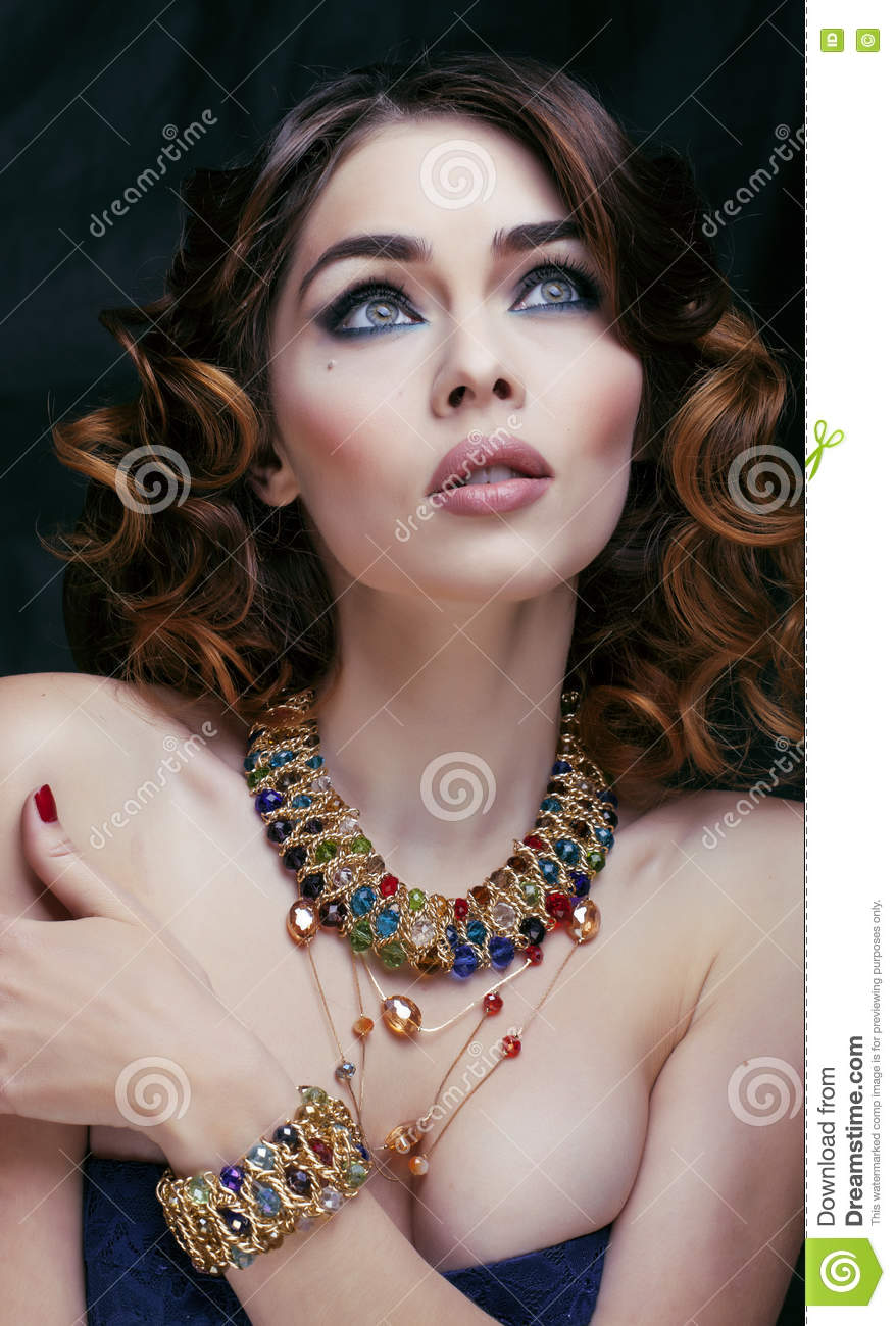 Beauty rich woman with luxury jewellery looks like mature for Luxury women