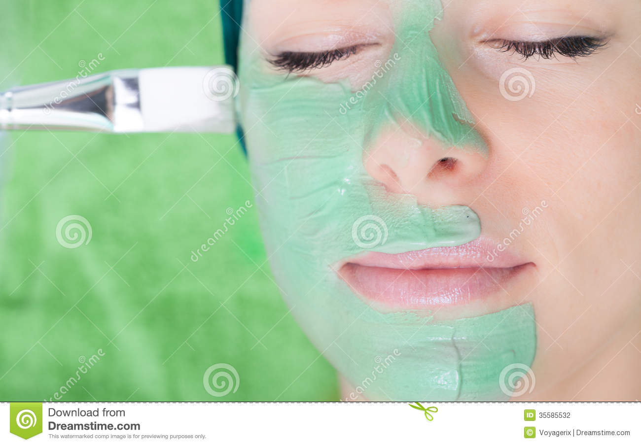 Beauty salon cosmetician applying facial mask at woman for A trial beauty treatment salon