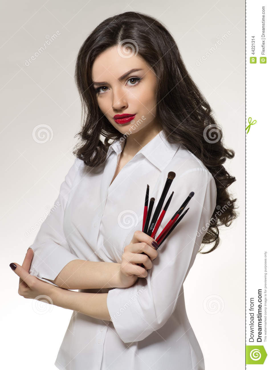 Beauty salon makeup artist with professional brushes stock for Photo salon