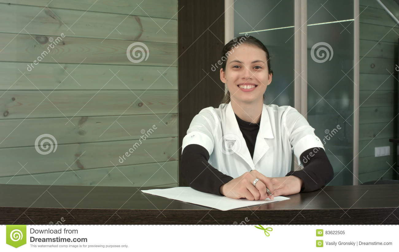 beauty salon receptionist filling in form and greeting customers beauty salon receptionist filling in form and greeting customers a happy smile stock video video 83622505