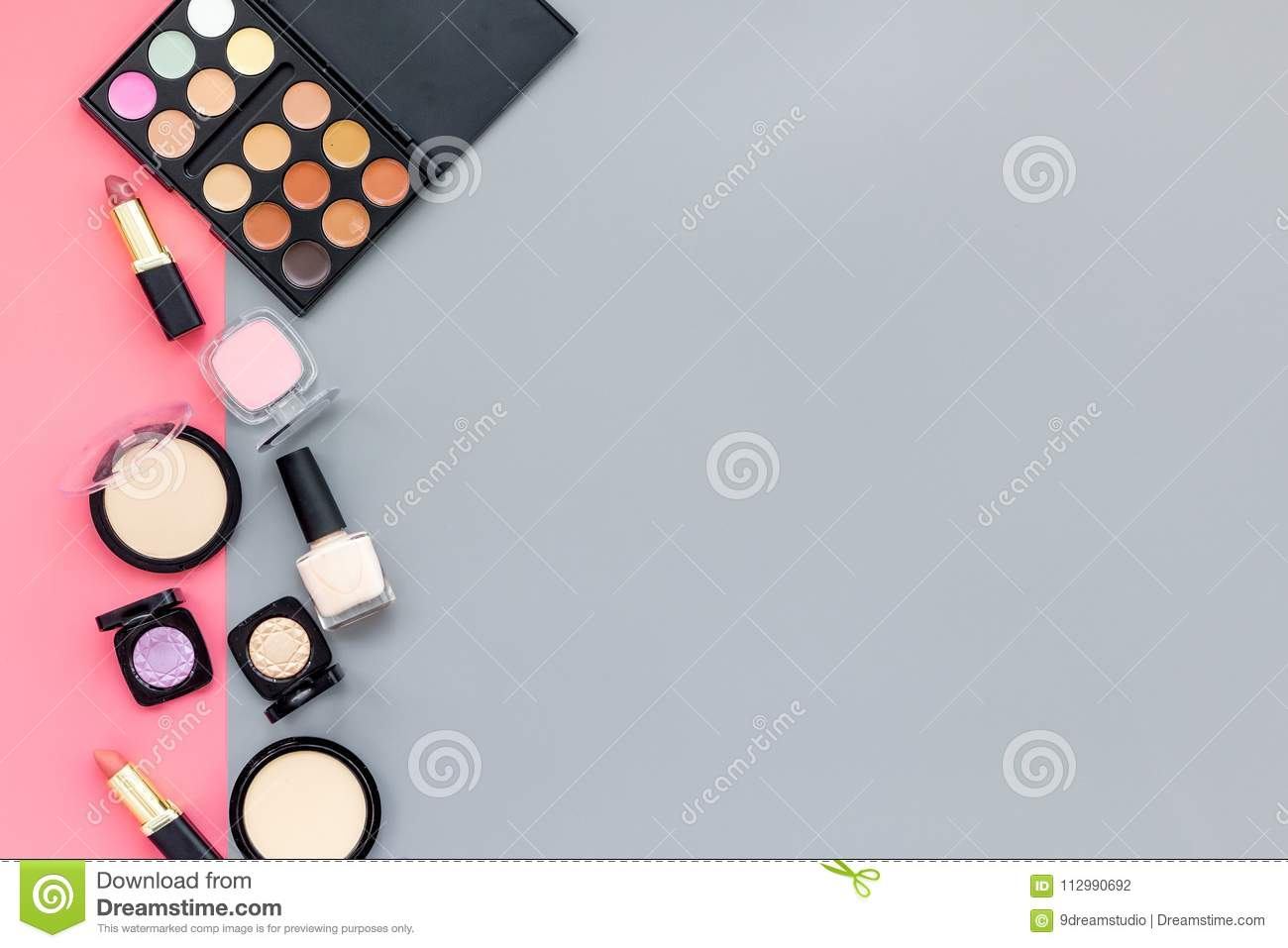 Beauty set with decorative cosmetics. eyeshadow palette, brushes on pink and gray background top view mockup