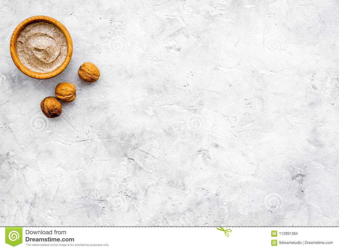 Beauty set with natural walnut scrub for spa on stone background top view mockup