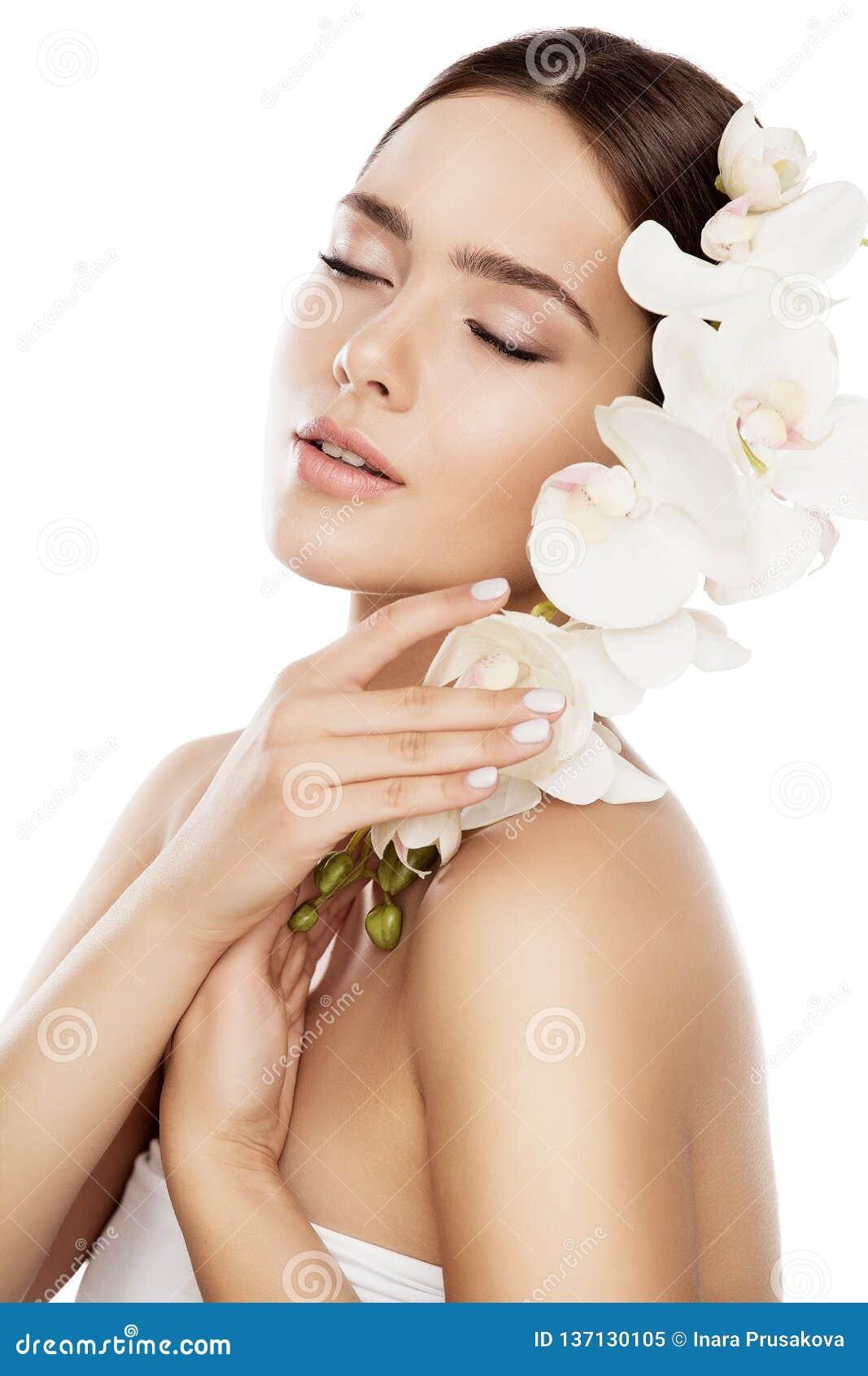 Beauty Spa φροντίδα δέρματος, πρόσωπο φυσικό Makeup γυναικών και λουλούδι ορχιδεών, πρότυπο μόδας