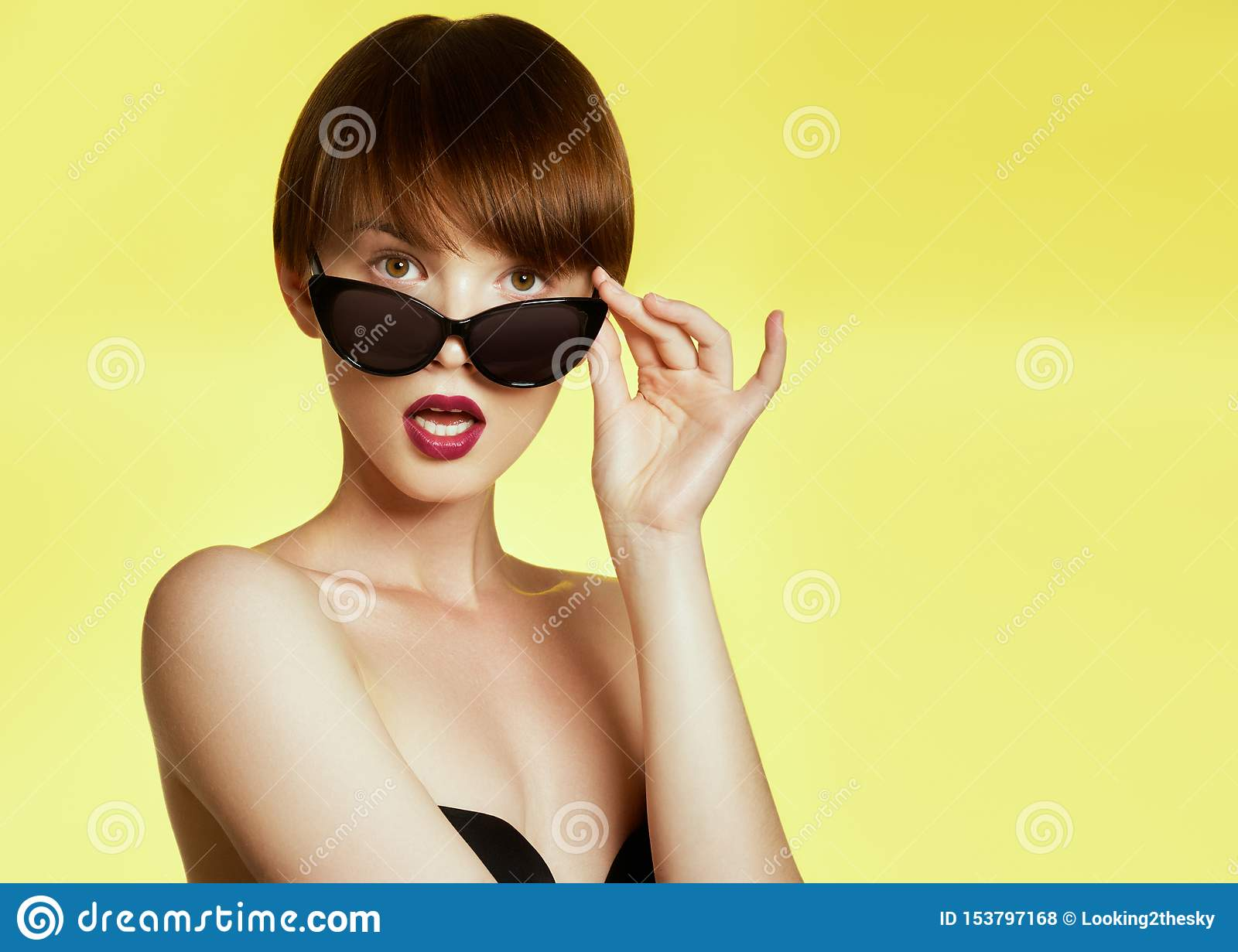 Beauty surprised fashion funny model girl wearing sunglasses. Young girl. Expressing positive emotions, smile. Beautiful