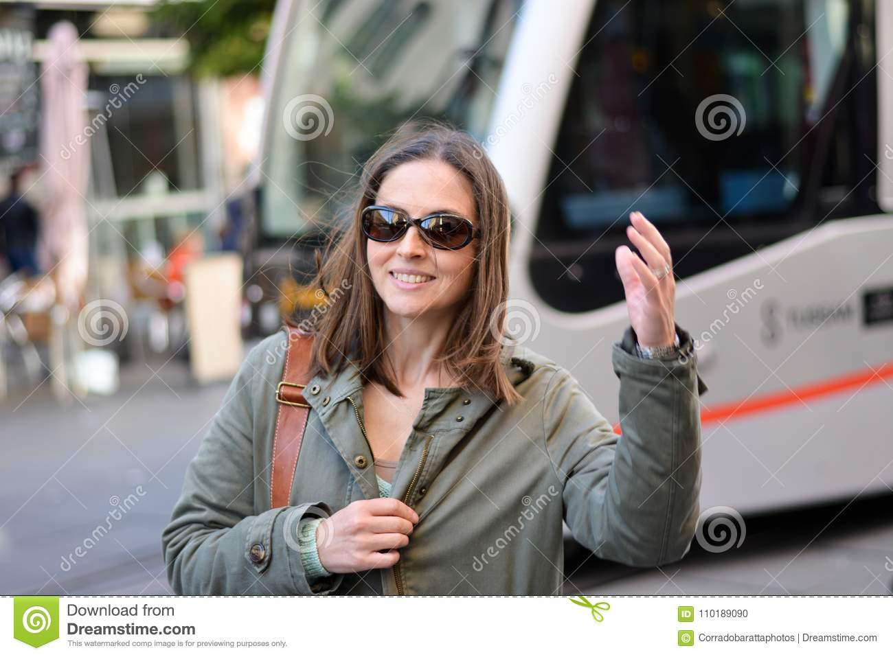 The newly arrived woman greets her hand after getting off the subway in Seville, Spain