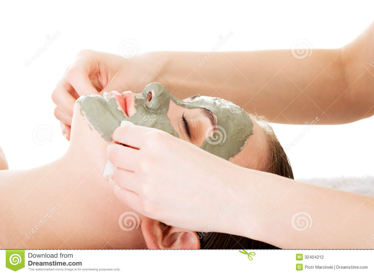 beauty treatment in spa salon woman with facial clay mask