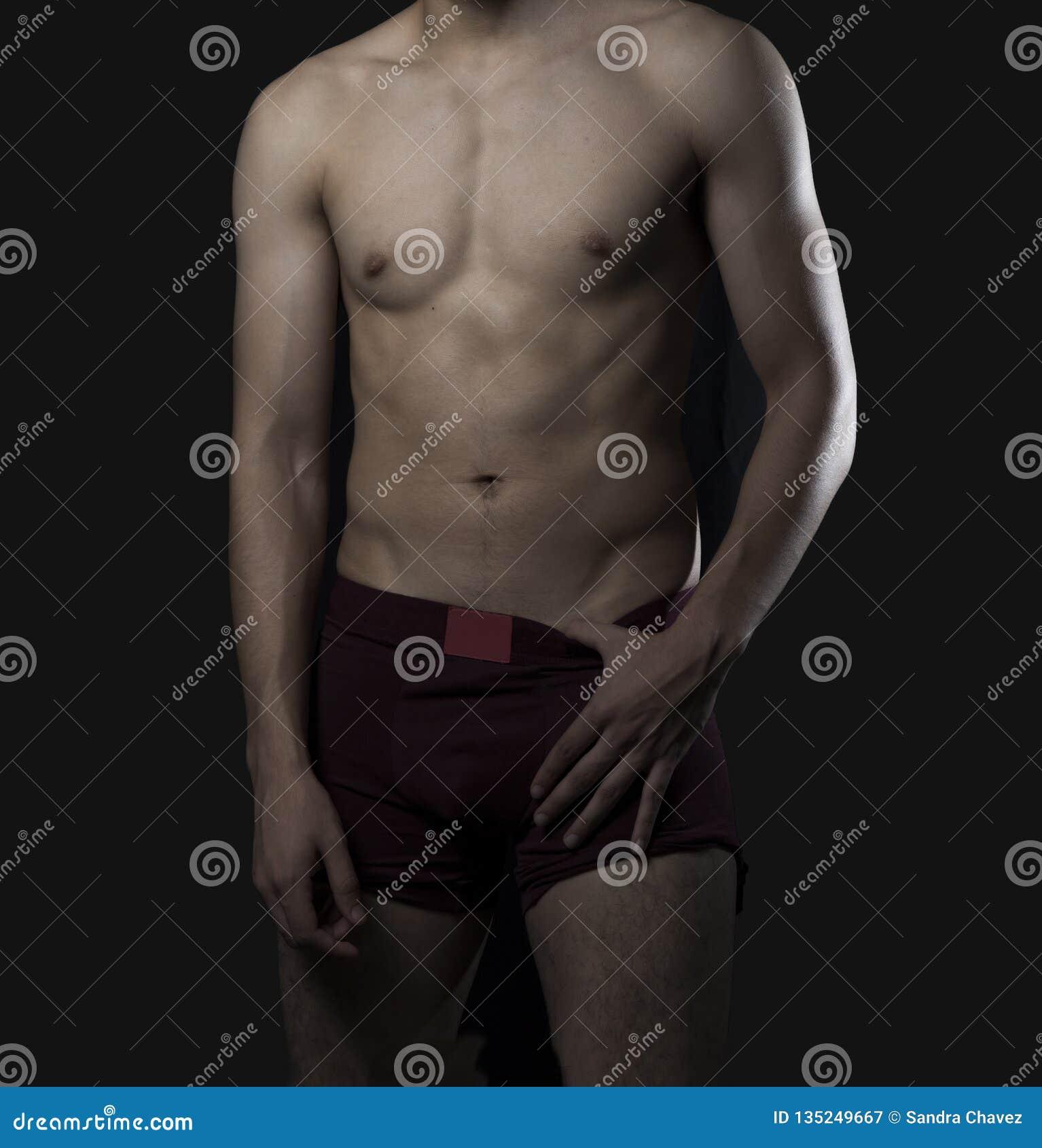 Model in underwear showing her athletic body.