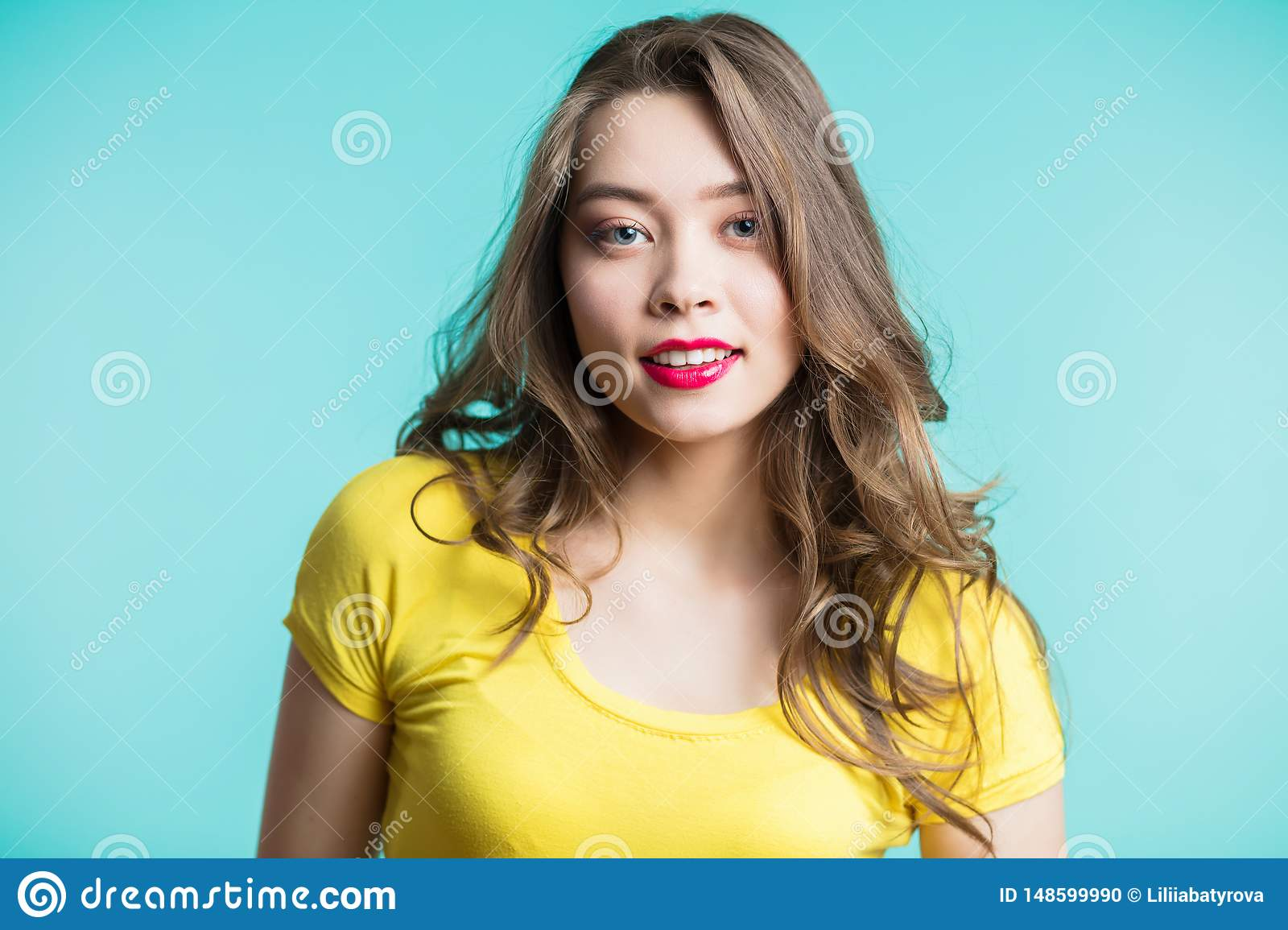 Beauty Woman face Portrait. Beautiful Spa model Girl with Perfect Fresh Clean Skin. Blonde female looking at camera and smiling.