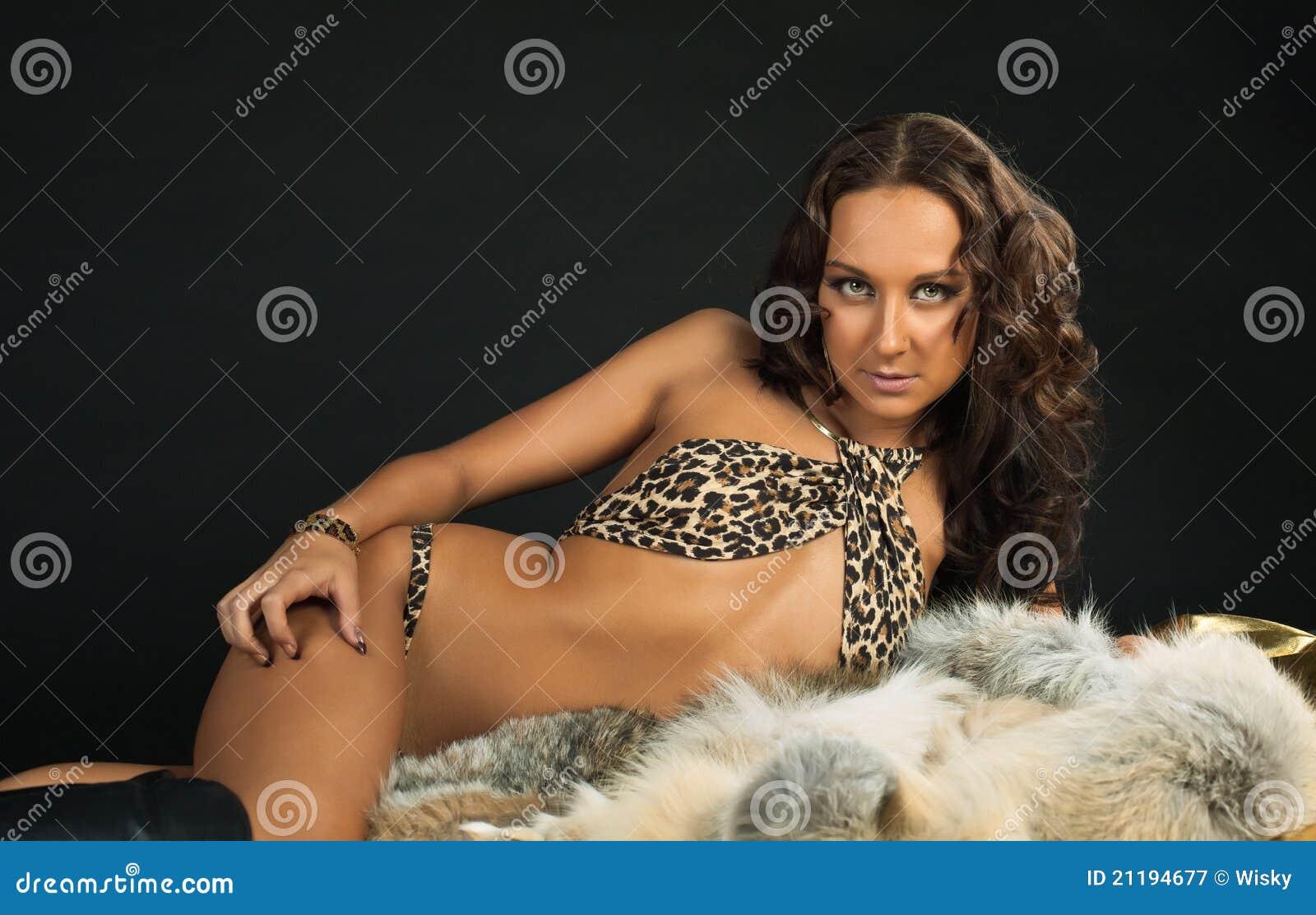 Beauty woman in leopard bra portrait on fur