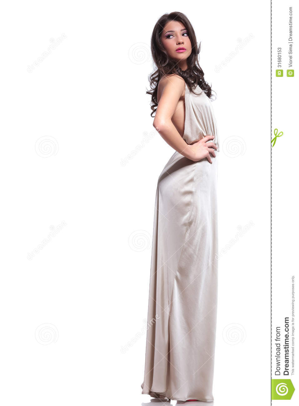 Full length photo of a young beauty woman looking back, over her ...