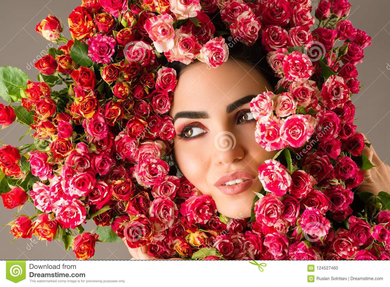 Beauty woman makeup face with red roses flower wreath on head