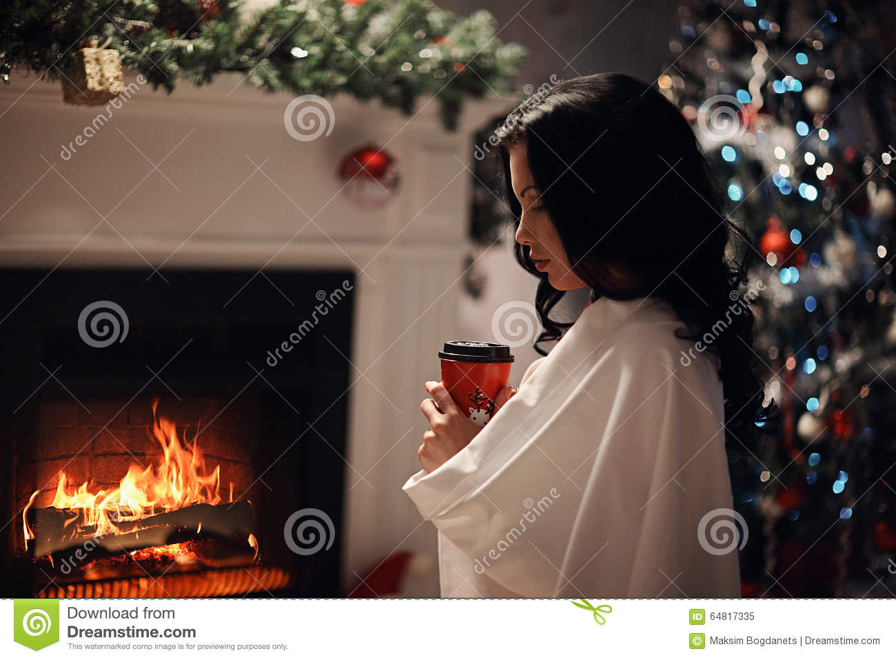 Beauty woman, perfect smile resting on the floor at home with a fireplace