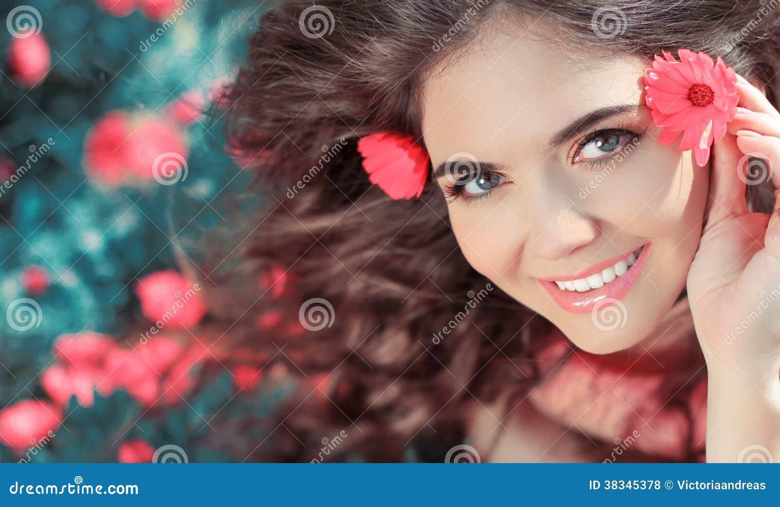 Beauty woman portrait with flowers. Free Happy Girl Enjoying Nat