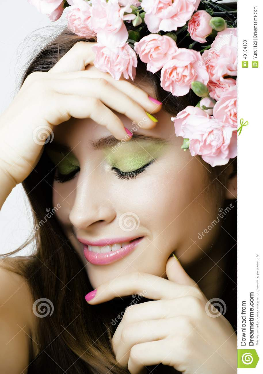 Beauty young real woman with pink flowers and make stock for Actual beauty salon