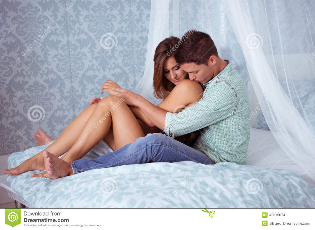 Beautyful couple in romantic mood in their bedroom