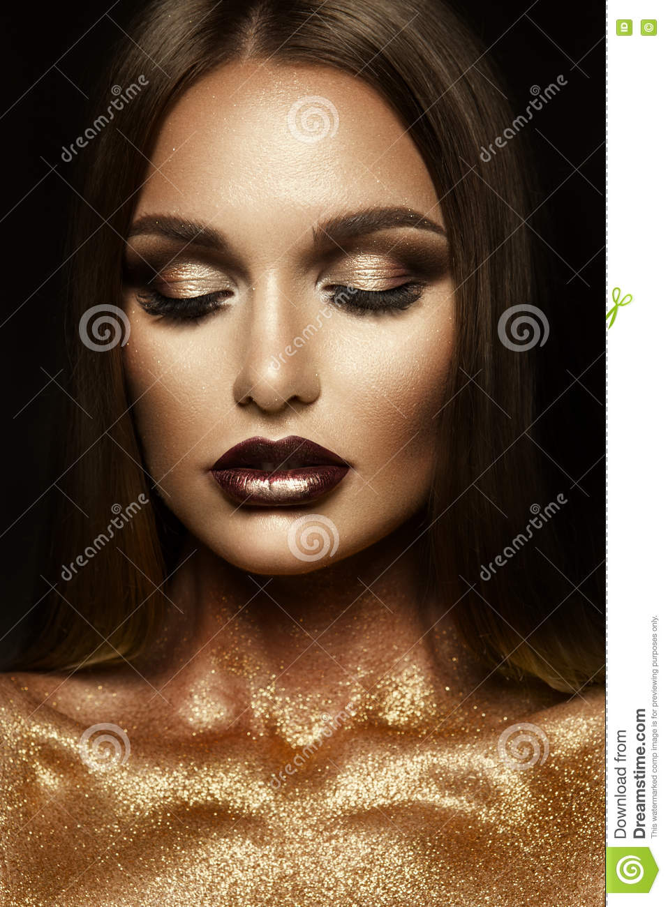 Beautyful Girl With Blue Glitter On Her Face Stock Photo