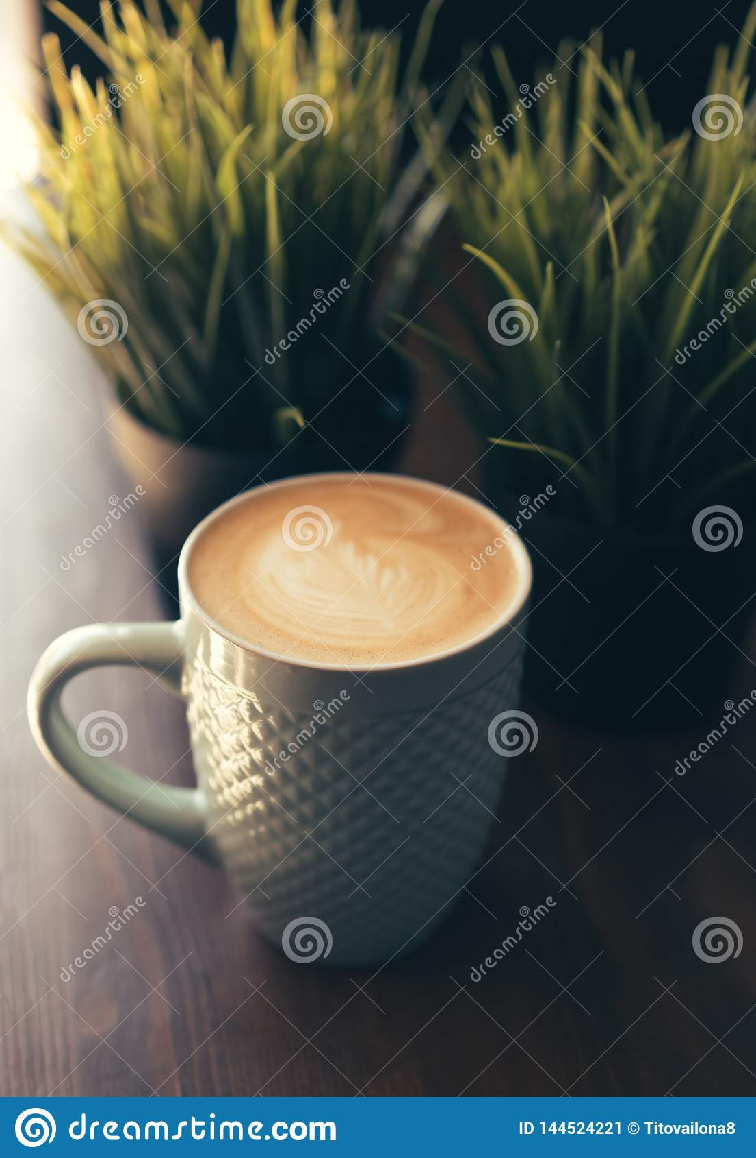 Becher mit Cappuccino