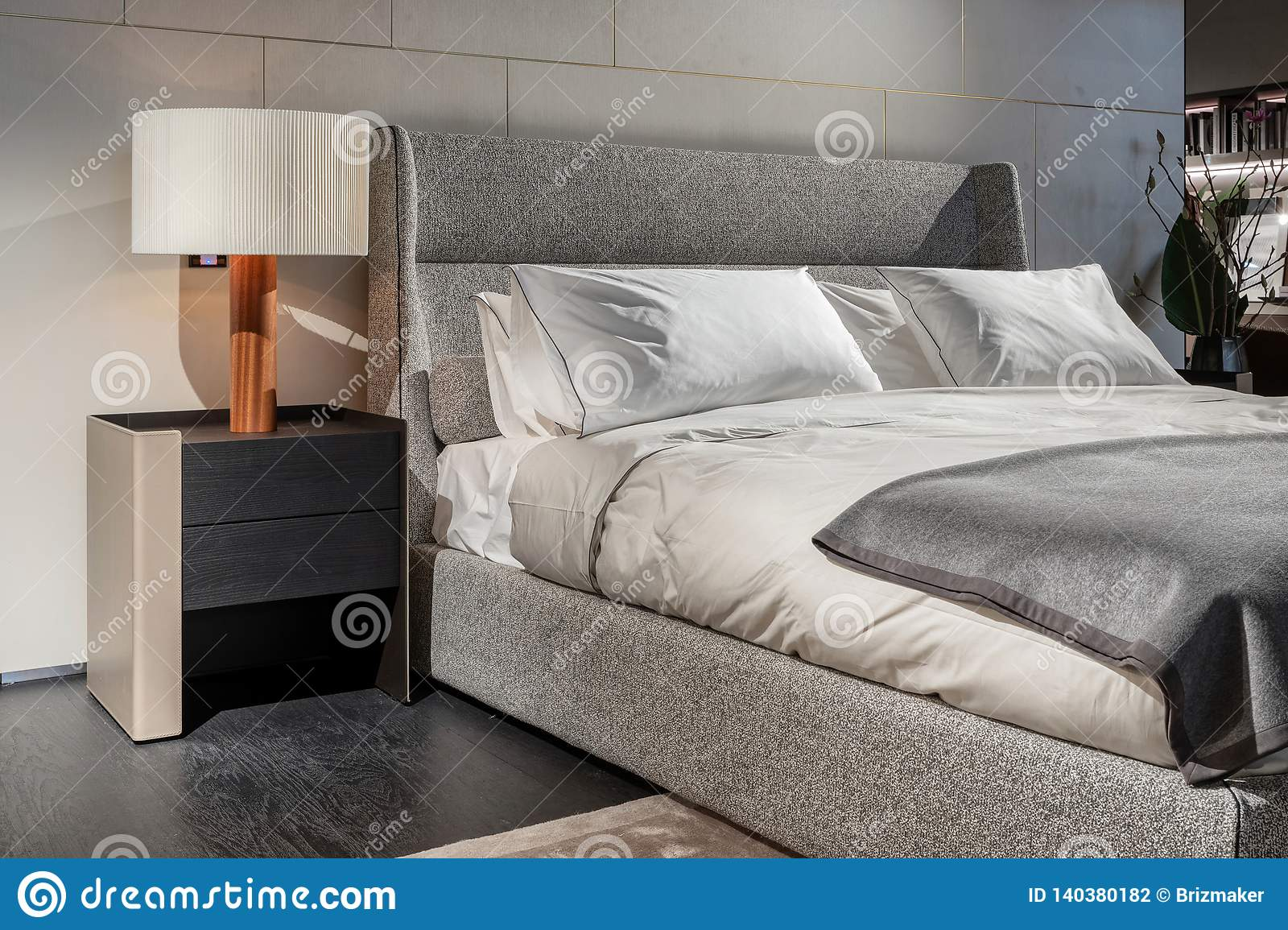 Bed In Bedroom Interior With White Lamp On The Bedside Table