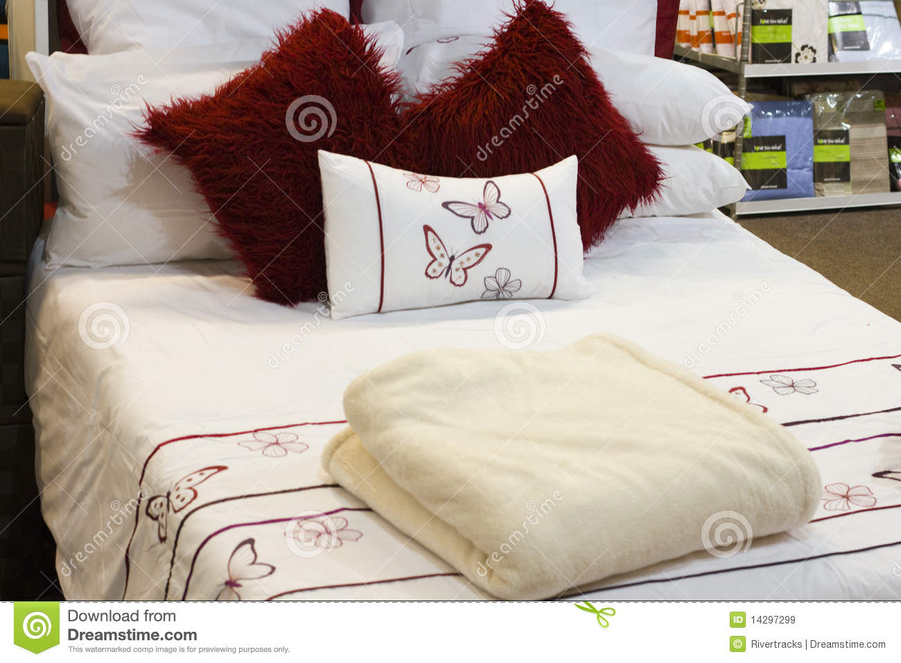 Bed with linen in a house accessory retail store