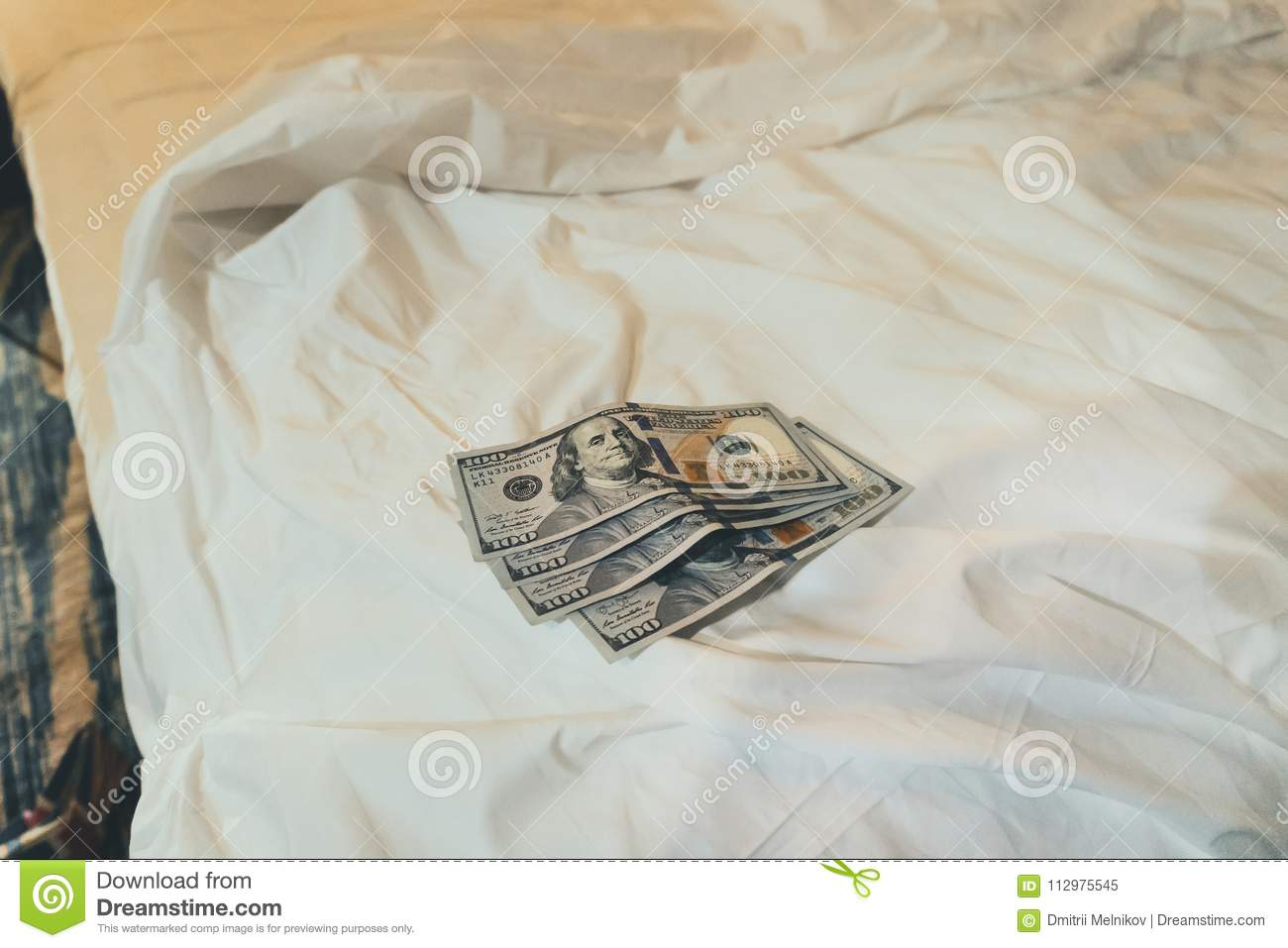bed and money to symbolize the cost of sex.