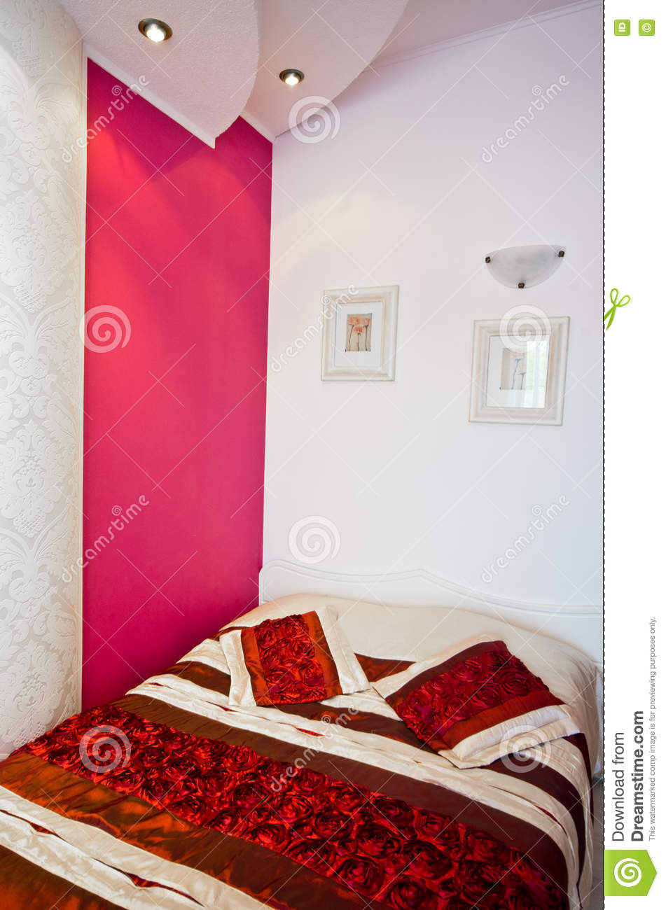 Bed In Room With Red Accent Wall Stock Photo Image Of Home
