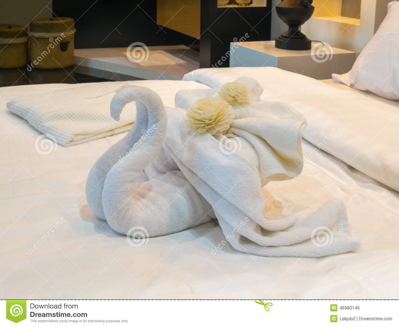 bed suite decorated with flowers and swan towel stock