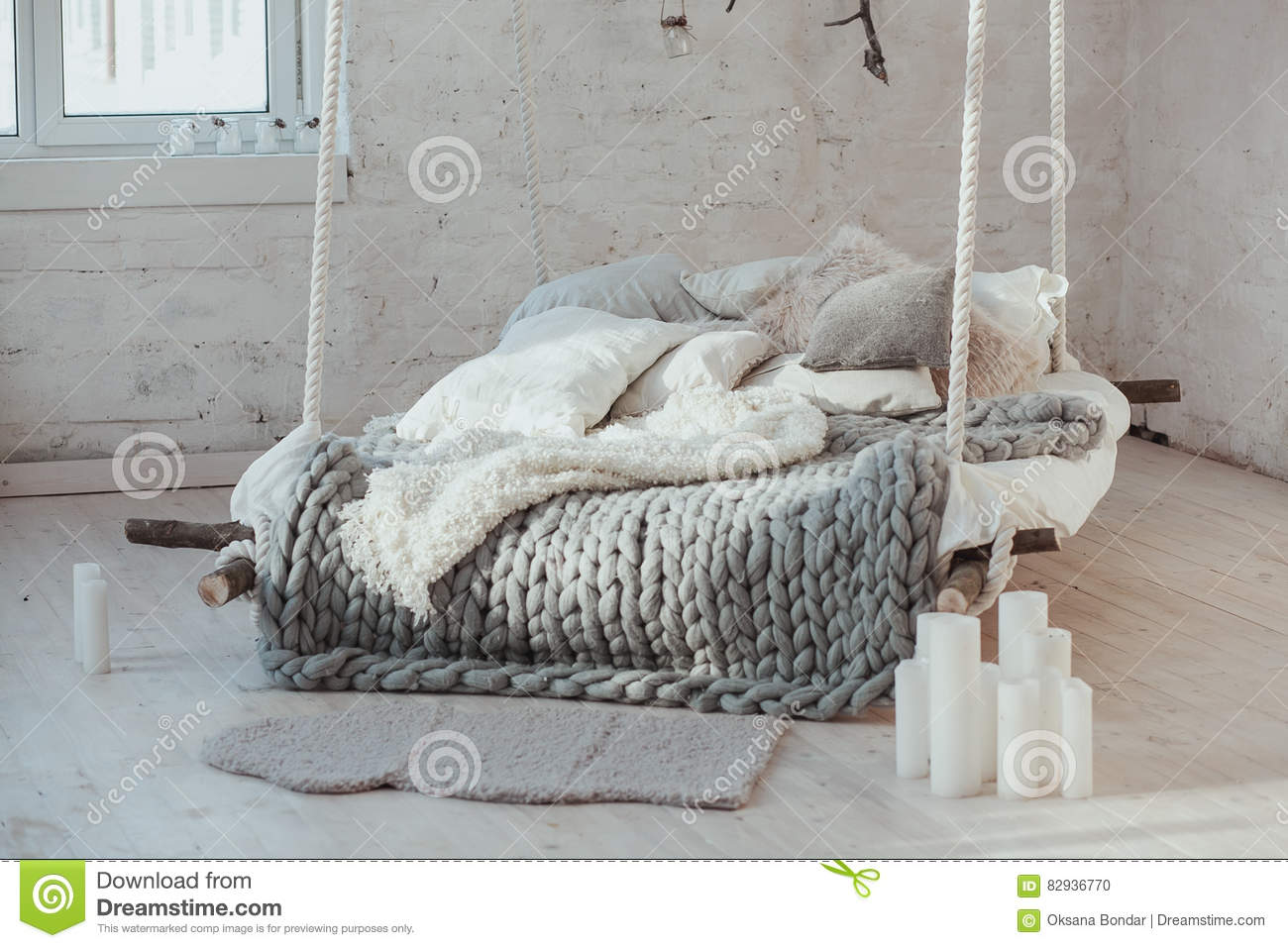 dc29b773003 The Bed Suspended From The Ceiling. Grey Big Cozy Blanket Knit ...