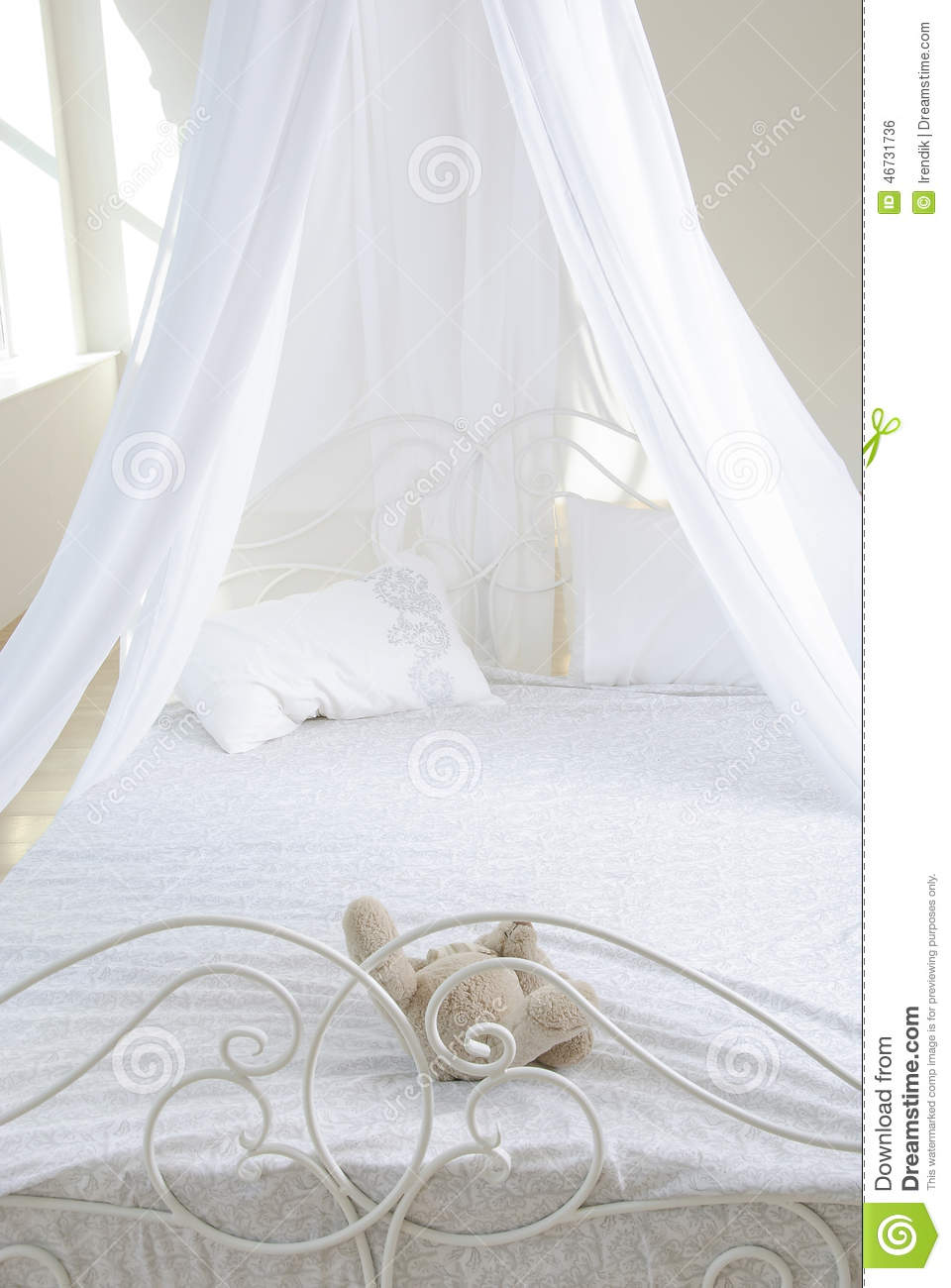 Old Fashioned Bedroom With Iron Frame Bed Stock Photo