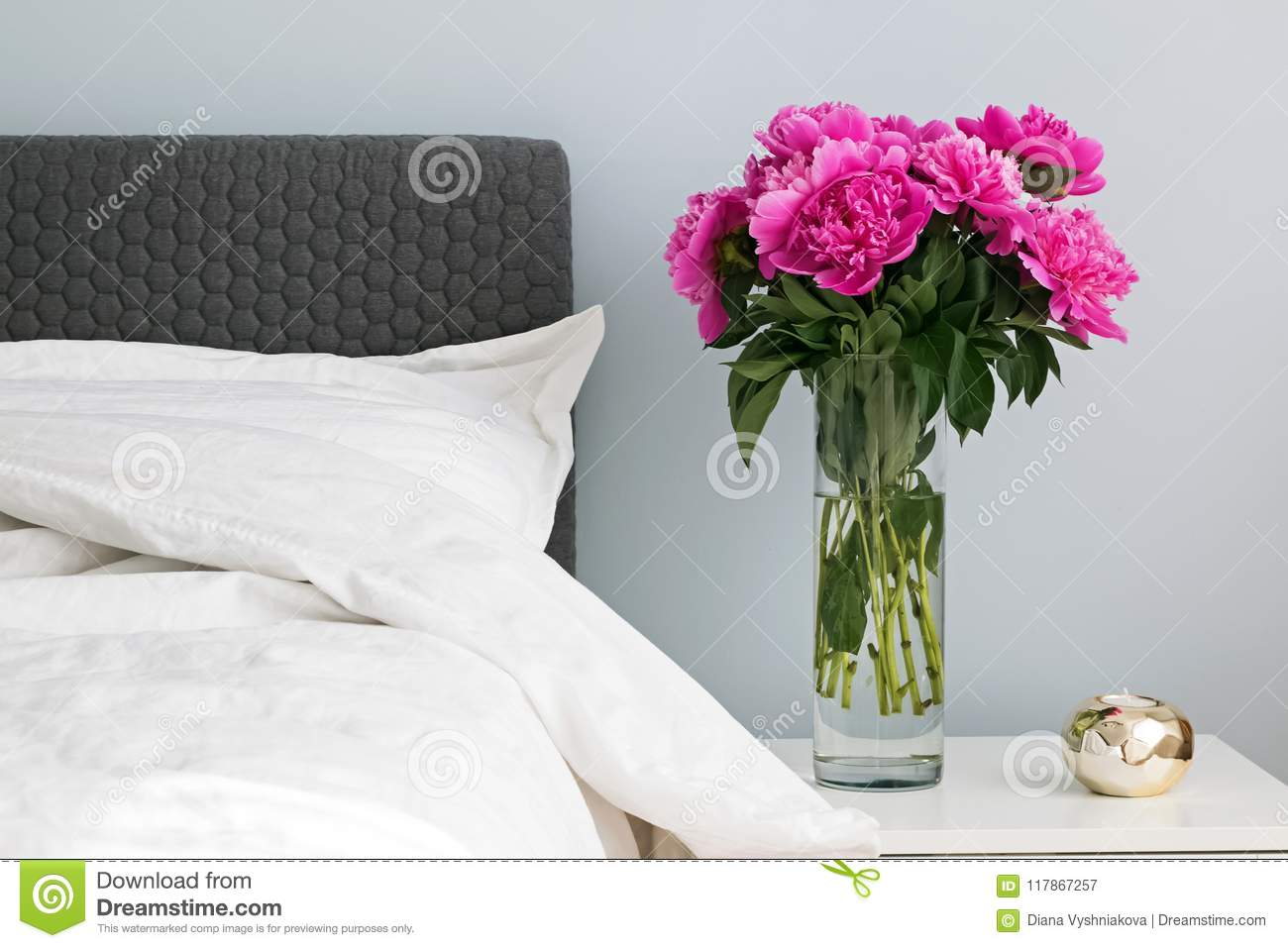 Bed With White Bed Sheets And Pink Peonies On The Nightstand ...