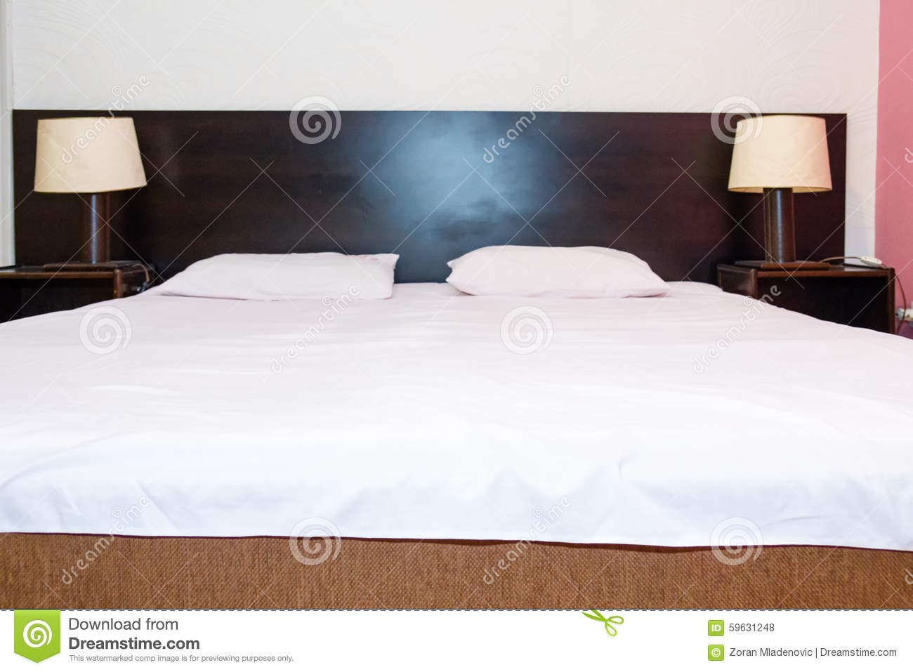 A white bed with 2 pillows in hotel room stock image 85064809 - Beautiful snooze bedroom suites packing comfort in style ...
