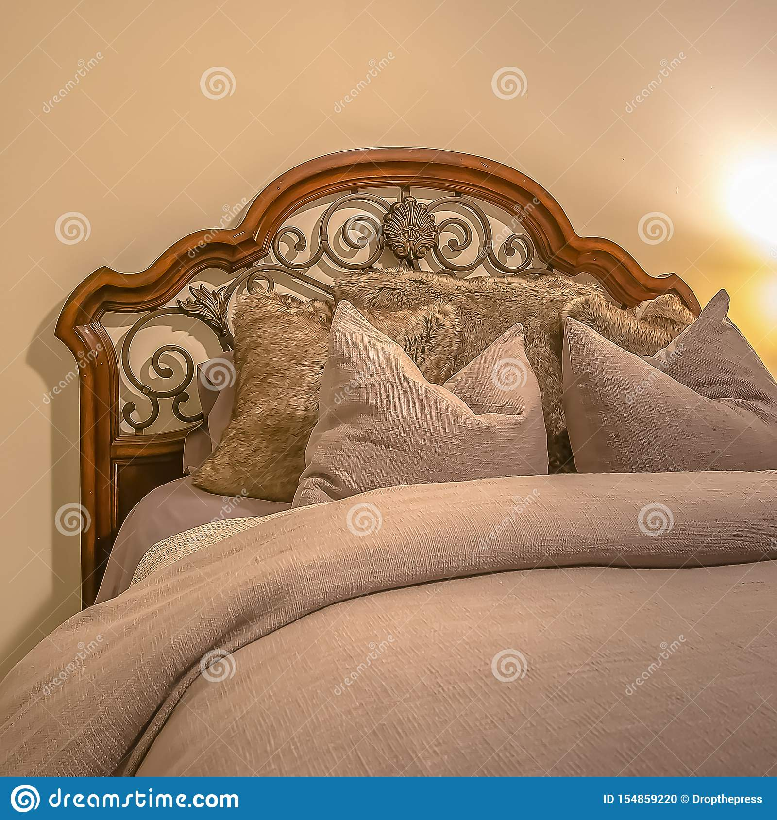 Bed With Wood And Wrought Iron Headboard Inside The Bedroom Of A Home Stock Photo Image Of Side Relaxation 154859220