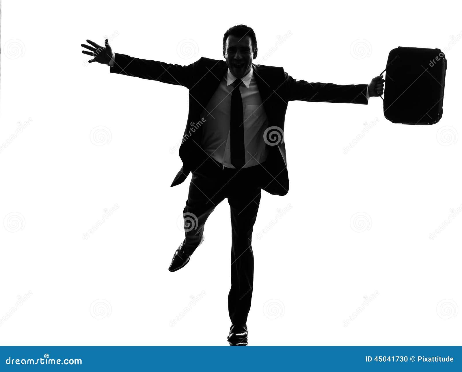 Bedrijfsmens die gelukkig wapens uitgestrekt silhouet in werking stellen