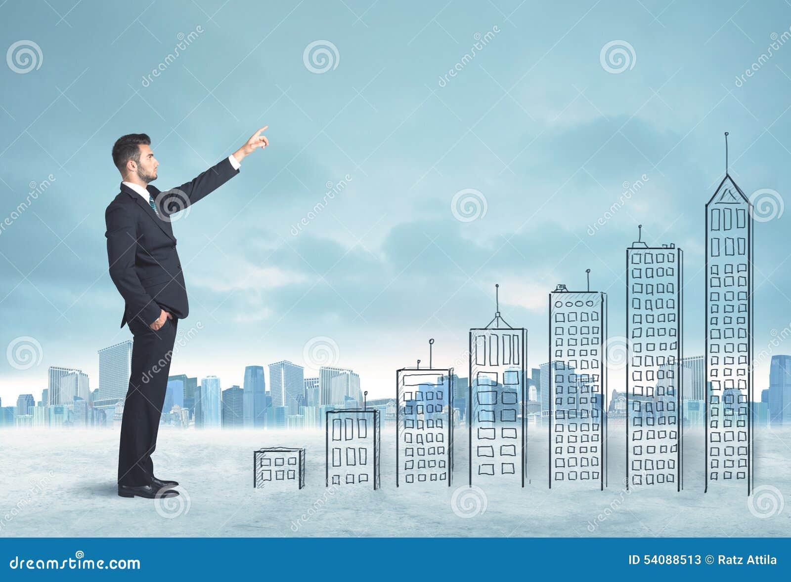 Bedrijfsmens die omhoog op hand getrokken gebouwen in stad beklimmen