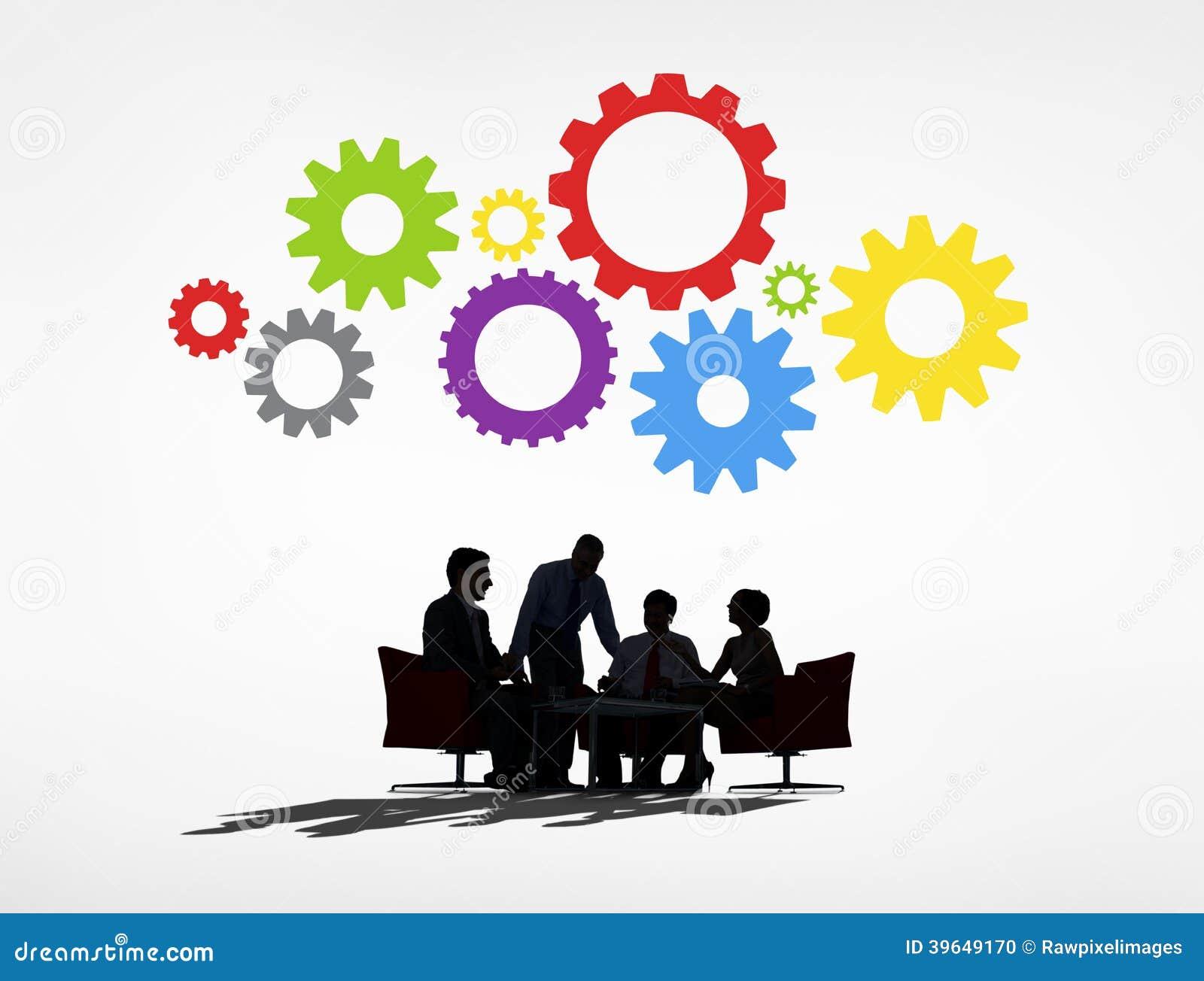 Bedrijfsmensen die een Vergadering en Toestellen hebben hierboven