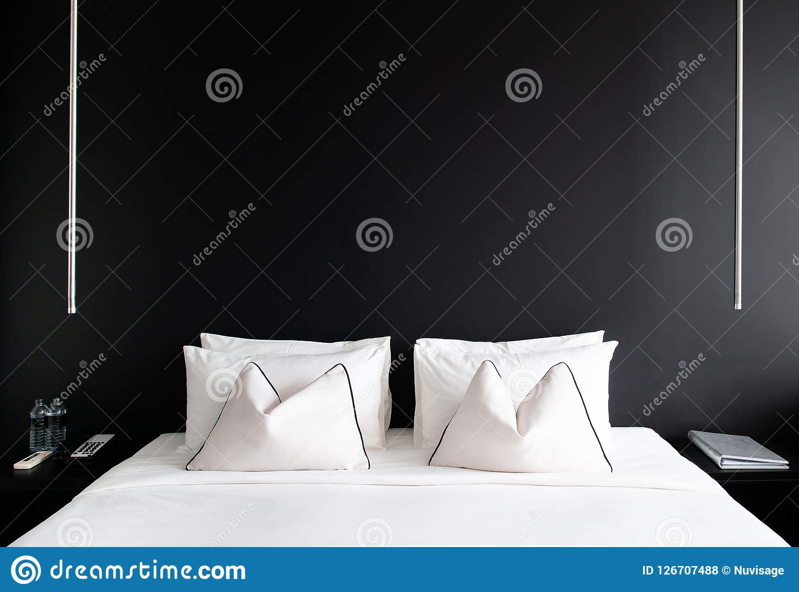 Bedroom With Black Wall White Bed Pillows Modern Side Table