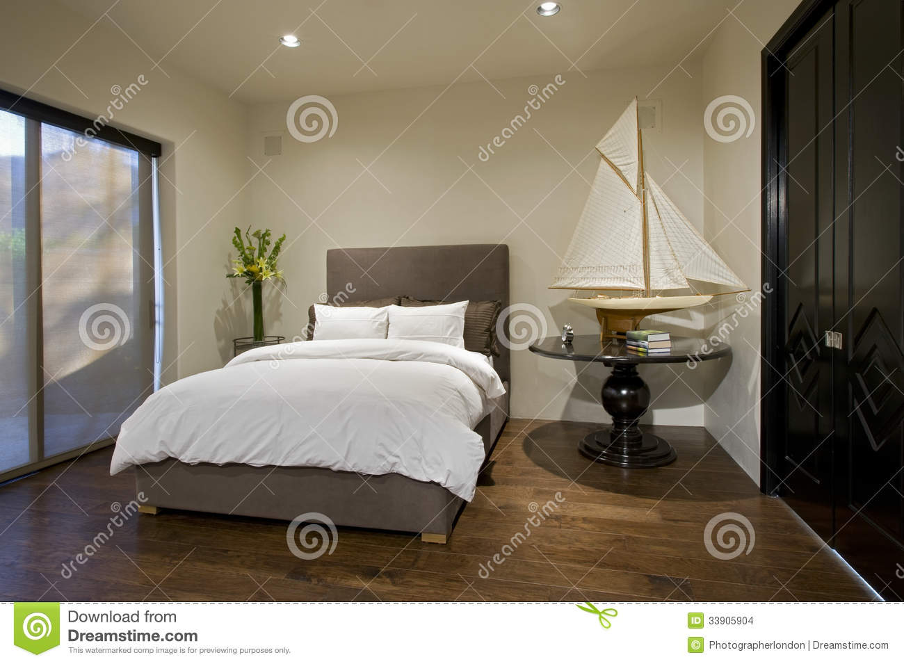 Bedroom With Boat Model On Side Table Stock Images Image