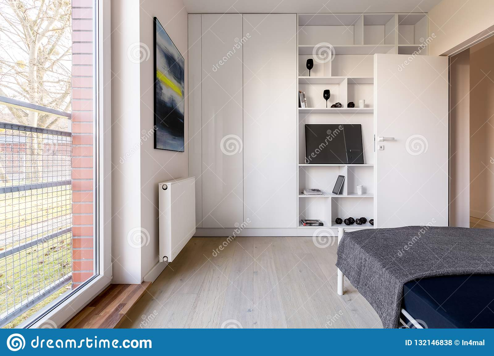Bedroom With Bookcase And Wardrobe Stock Photo
