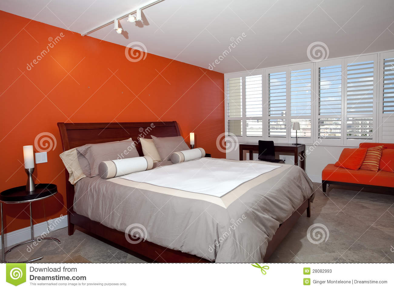 Bedroom with burnt orange wall stock photos image 28082993 for Burnt orange bedroom ideas