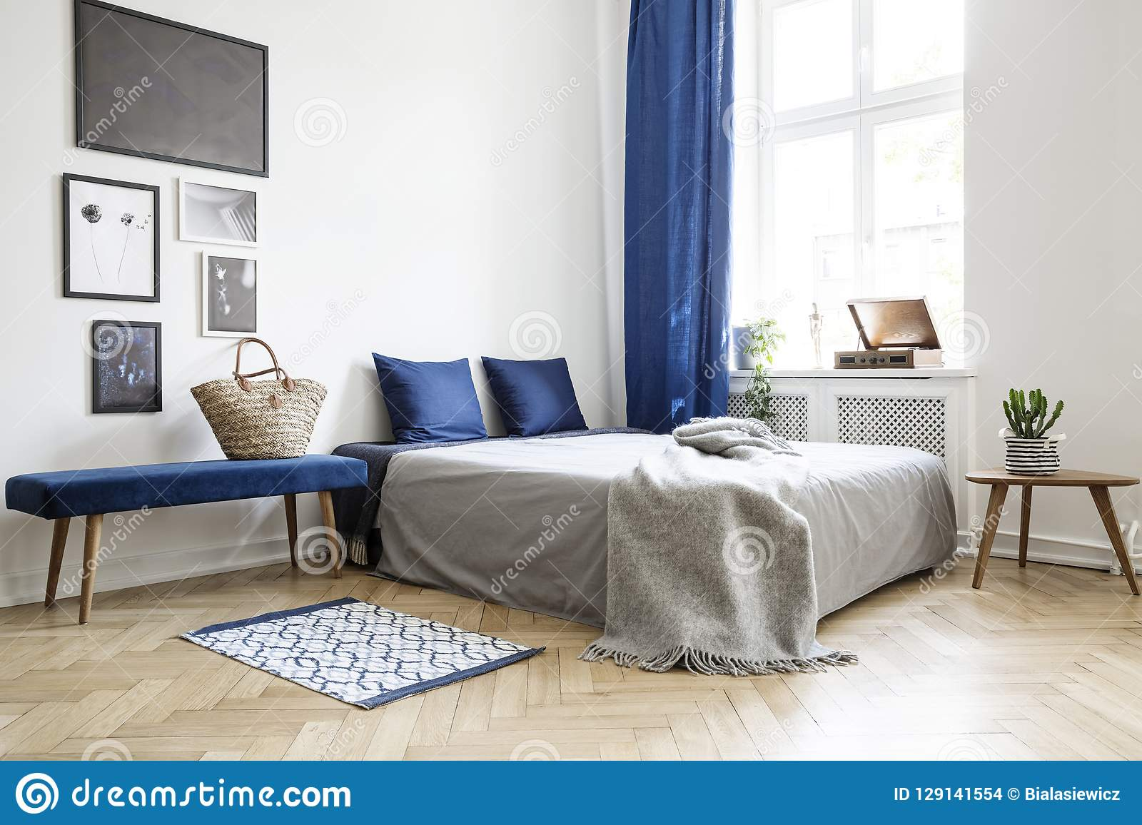 Bedroom Design In Modern Apartment. Bed With Dark Blue Pillows And ...