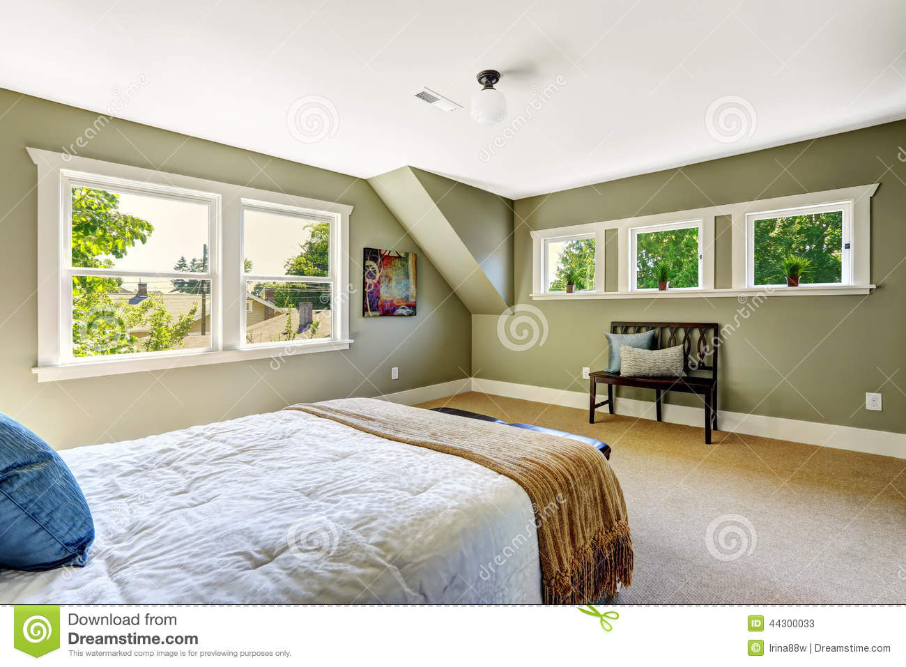 Bedroom With Green Walls And Vaulted Ceiling Stock Photo