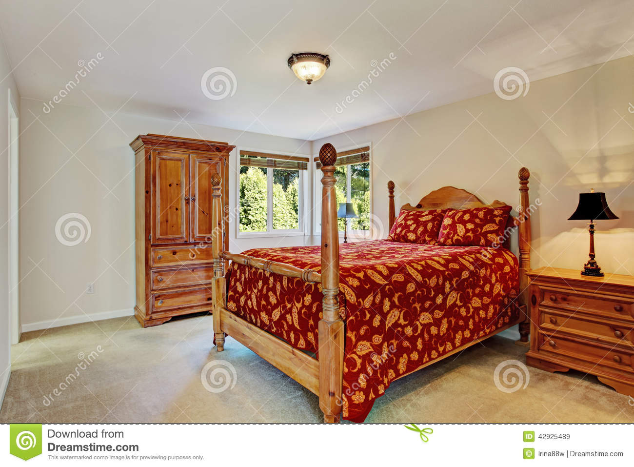 Bedroom with high pole bed and wardrobe stock photo - Bright house bedroom furniture ...