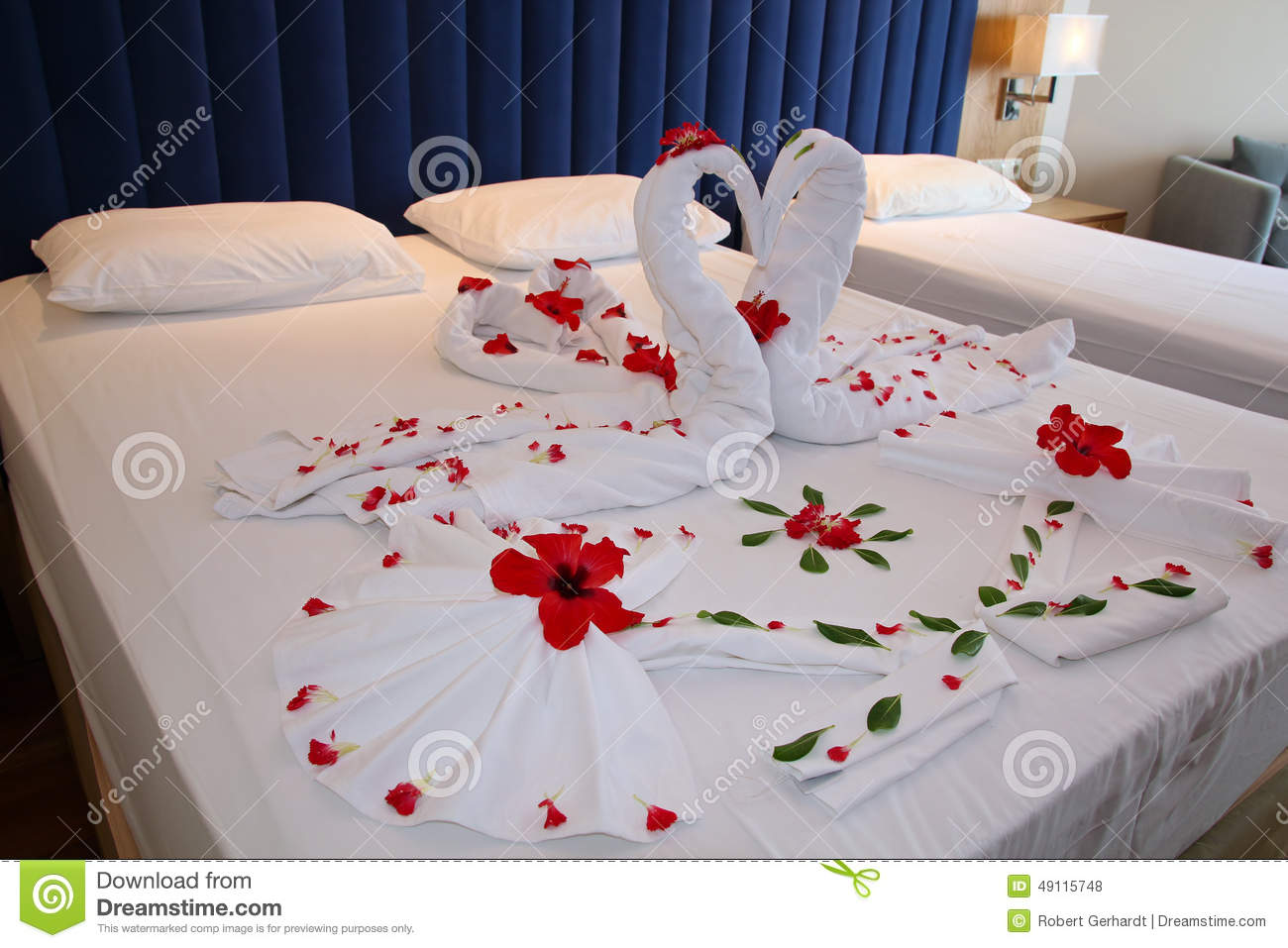 Bedroom in hotel suite with heart shaped decorations stock for Bed decoration by flowers
