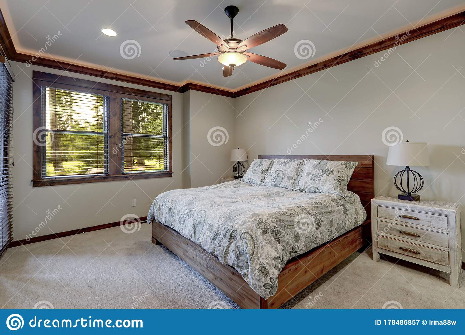 Bedroom Interior With Beige Walls And Wood Trim And Ceiling Fan Stock Image Image Of Bedroom Amazing 178486857